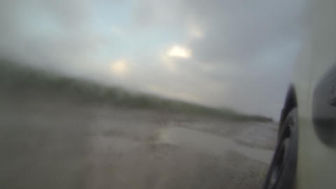 Driving in the rain on a road with puddles and mud Footage