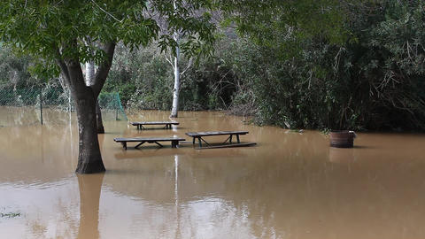 Picnic Benches Under Water In Flooded Area stock footage