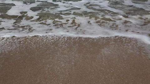 Sea waves hit rocks and beach Footage