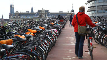 Bicycle Parking Lot In Amsterdam, Holland stock footage