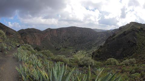 Hikers in La Caldera de Bandama in volcanic island Footage