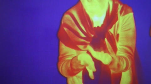 Woman warms her hands in front of infrared radiati Footage