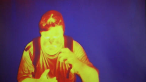 Infrared radiation thermal imaging camera of a man Footage
