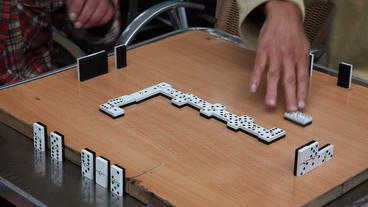 Retired Persons Senior Citizens Play Domino stock footage