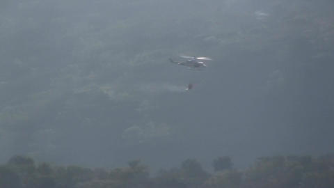 Helicopter airtankers spray against ferocious fire Footage