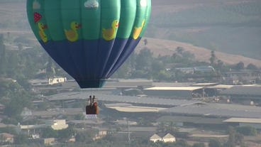 Hot Air Balloons Take Off At Sunrise Aerial stock footage