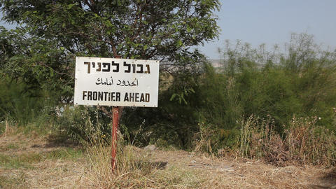 Frontier ahead sign in three languages on the bord Footage