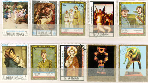 Stamp album with international stamps of art, peop Footage