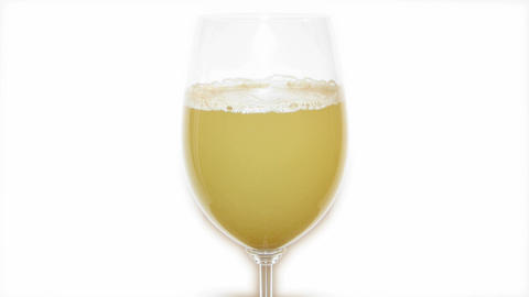 Genuine white wine fermentation with yeast in a gl Footage