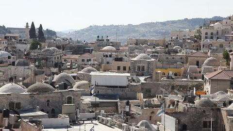 Skyline of old Jerusalem: a Jew prays on the roof Footage