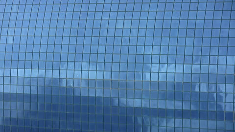 Timelapse Of Clouds Reflected In Corporate Office  stock footage