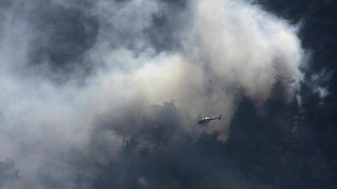 Israeli police helicopter inspects fire damage Footage