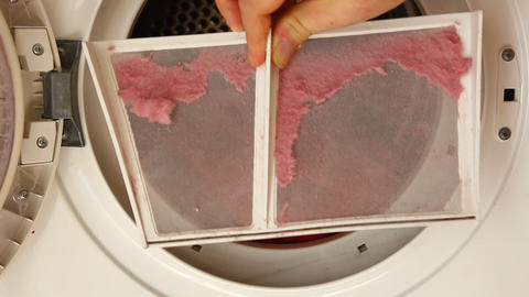 Hand cleaning lint filter in laundry dryer Footage