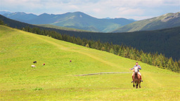 Rural Rider In The Mountains stock footage