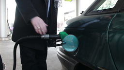 Refueling car - petrol station. Two sequences Live Action