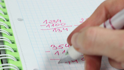 Child doing its math homework Live-Action