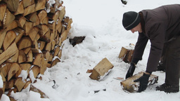 Man chopping wood in frosty winter. 1 Footage