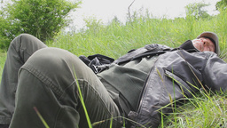 Man Resting In The Meadow stock footage