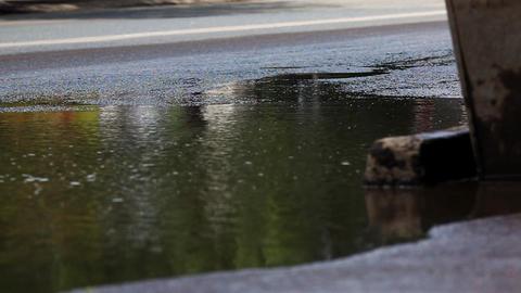 puddle on street Stock Video Footage