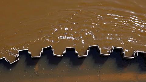 Dirty water on bridge pillar Stock Video Footage