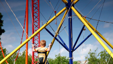 Child Jump on Rope park amusement Stock Video Footage