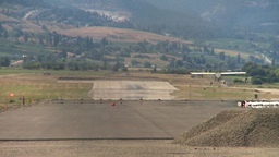 HD2008-8-2-22 light aircraft landson runway Kelowna Footage