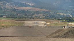 HD2008-8-2-22 light aircraft landson runway Kelowna Stock Video Footage