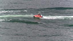 HD2008-8-3-33 Okan Lake motorboat rubber tube Stock Video Footage