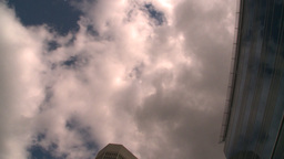HD2008-8-8-16 drive up DT buildings clouds Stock Video Footage