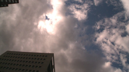 HD2008-8-8-18 drive up DT buildings clouds Stock Video Footage