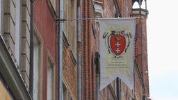 The flag with crest city of Gdansk, Poland Live Action