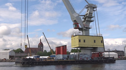 Huge Port Crane On A Barge Floats On The River stock footage