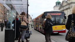 People Board The City Bus. Old Town In Warsaw stock footage