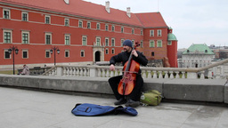A street musician playing the cello, Warsaw Footage