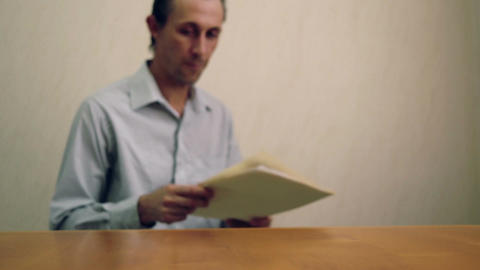 Male Reading and Throwing File Folder Footage