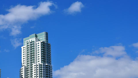 Skyscraper With Passing Clouds stock footage