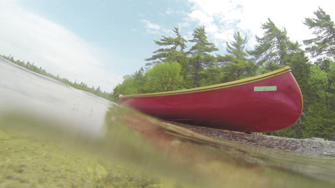 Canoe on the shore of a lake Footage