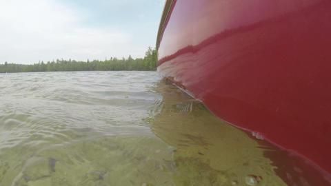 Canoe slowly navigating on a lake Footage