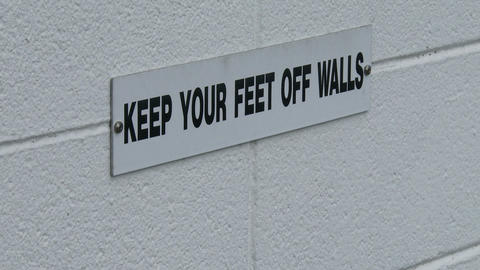 Keep your feet off walls sign Live Action