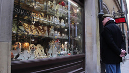 Man watching a souvenir shop window, Warsaw Stock Video Footage