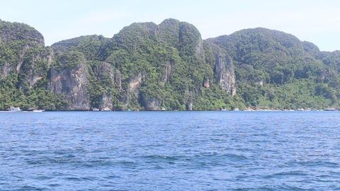 Boat floats ocean island Stock Video Footage