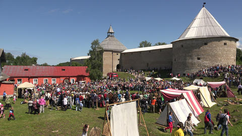 A crowd of people near the fortress of Old Ladoga. Footage