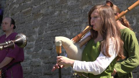 The musician plays the bagpipes. 4K Footage