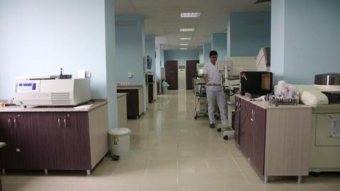 IZMIR, TURKEY - JANUARY 2013: Male scientist at wo Stock Video Footage