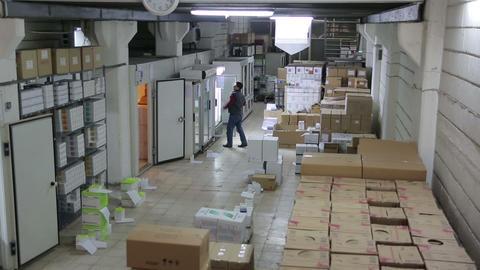 IZMIR, TURKEY - JANUARY 2013: Man working in stora Footage