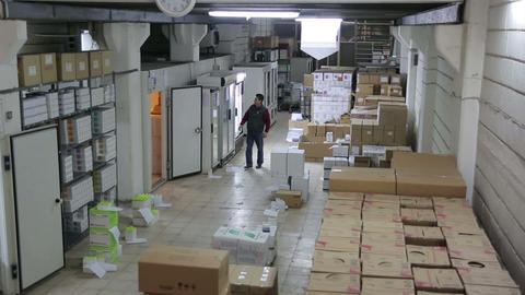 IZMIR, TURKEY - JANUARY 2013: Man working in stora Stock Video Footage