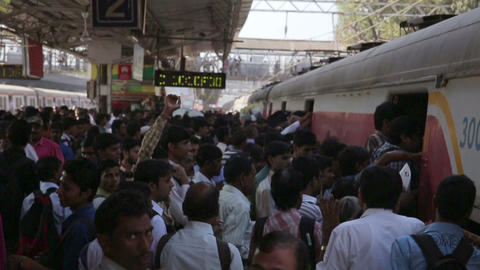 MUMBAI, INDIA - MARCH 2013: People getting on over Stock Video Footage