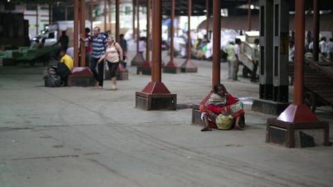 MUMBAI, INDIA - MARCH 2013: Beggar on railway stat Stock Video Footage