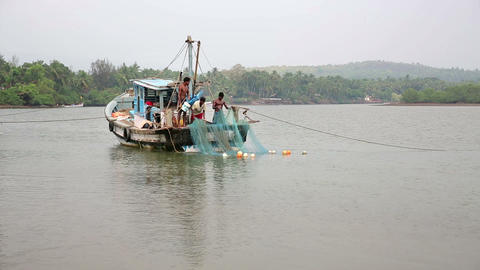 GOA, INDIA - MARCH 2013: Fishing crew casting nets Stock Video Footage