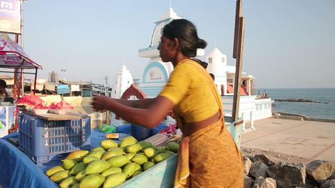KANYAKUMARI, INDIA - MARCH 2013: Women selling fru Footage